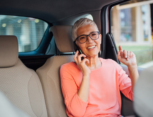 woman on phone in car